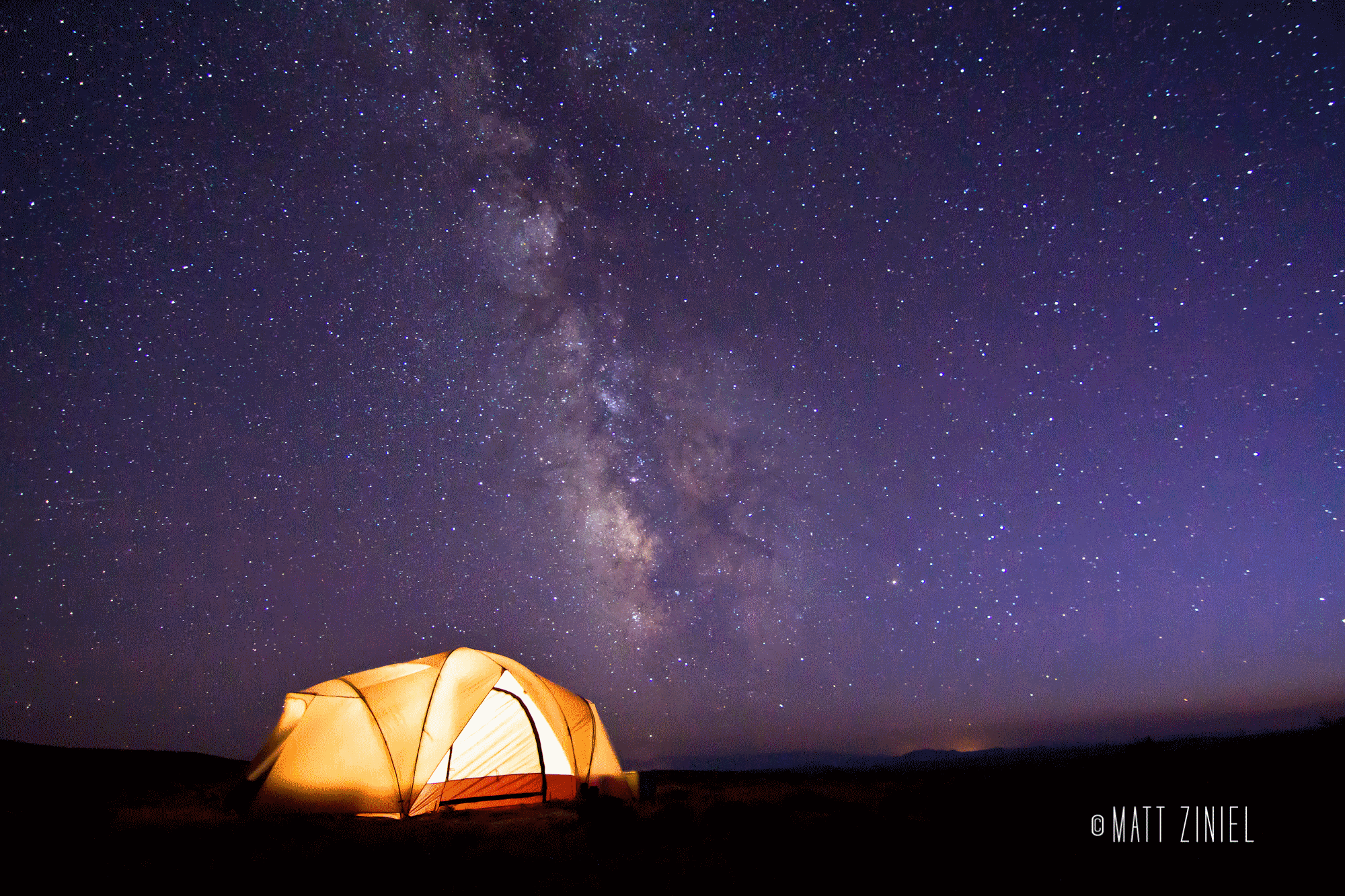 Camping out under the Milky Way in central Wyoming, by photographer Matt Ziniel.