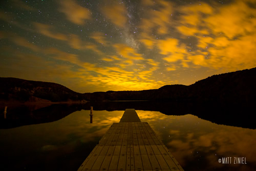 Milky Way through the clouds over Santa Cruz Lake in New Mexico