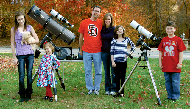 Barry E and Family: (L-R): Emma (holding Buddy), Abigail, Barry, Angelina, Hannah and Noah. The equipment (left): Orion 8 inch f/4.9 on the Atlas EQ-G mount with the StarShoot autoguiding package on top. The equipment (right): Orion SkyView Pro mount, Orion ED80 80mm f/7.5 Apochromatic Refractor Telescope. The equipment (middle rear): Light box, Bahtinov mask, Canon 40D DSLR, various Orion eyepieces, and the laptop.