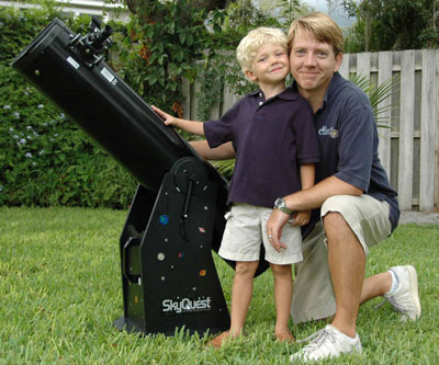 Michael W. and 5 yr. old son Jace with an Orion Dob!